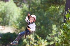 Boy at adventure park Stock Photo