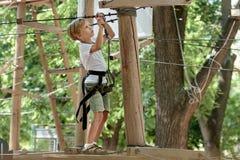 Boy in adventure park royalty free stock photos