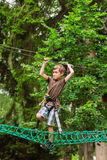 Boy in adventure rope park Stock Photos