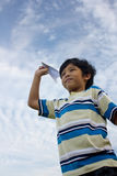 Boy and aeroplane Stock Images