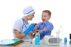 Boy is afraid of injections. Stock Photos