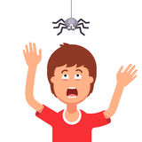 Boy afraid of a spider hanging from the top Stock Photography