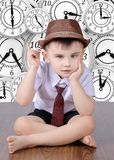 The boy is against the clock stock image