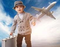 Boy against flying plane Stock Images