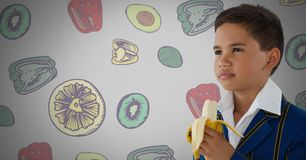 Boy against grey background with banana and fruit and vegetable illustrations. Digital composite of Boy against grey background with banana and fruit and Royalty Free Stock Photos