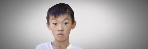 Boy against grey background with bewildered stunned expression Royalty Free Stock Photos