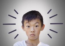 Boy against grey background with bewildered stunned expression and radial lines Royalty Free Stock Images