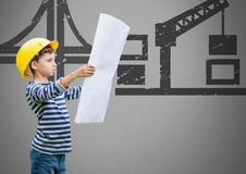 Boy against grey background with building plans blueprint and construction illustrations. Digital composite of Boy against grey background with building plans Royalty Free Stock Photos