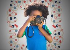 Boy against grey background with camera and colorful pattern. Digital composite of Boy against grey background with camera and colorful pattern Stock Images