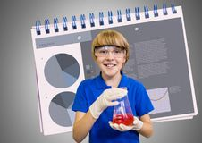 Boy against grey background with science equipment and notepad. Digital composite of Boy against grey background with science equipment and notepad Royalty Free Stock Photo