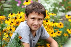 Boy against summer flower Stock Photo