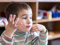 A boy at the age of 5 raising hand to the kindergarten. A boy at the age of 5 raising hand to the kindergarten Royalty Free Stock Images