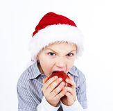 Boy in aht biting apple Stock Photo
