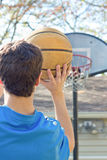Boy Aiming Basketball stock photography