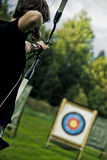 Boy Aiming with Bow Stock Photography