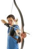 Boy aiming with bow an arrow stock image