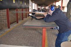 Boy aiming gun Stock Photography