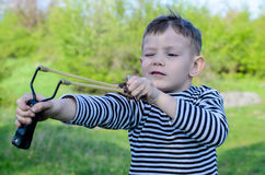Boy Aiming Sling Shot Stock Images