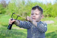 Boy Aiming Sling Shot Royalty Free Stock Images