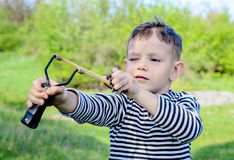 Boy Aiming Sling Shot Royalty Free Stock Photos