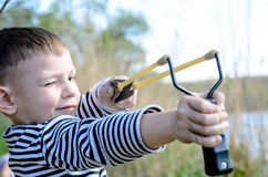 Boy Aiming Sling Shot Stock Photos