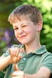 Boy Aiming Slingshot In Garden Stock Photo