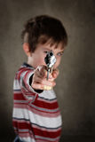 Boy aiming toy gun, shallow focus Royalty Free Stock Photos