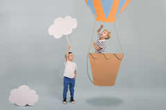 Boy in air balloon. Pointing the sky royalty free stock photography