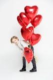 Boy with air balloons Stock Photos