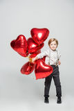Boy with air balloons royalty free stock images