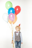 Boy with air balloons Royalty Free Stock Image
