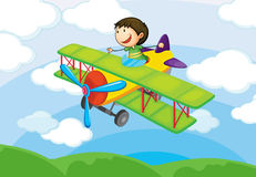 Boy on a air craft Royalty Free Stock Image