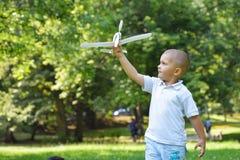 Boy with airpane Stock Photos