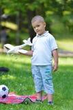 Boy with airpane Royalty Free Stock Photos
