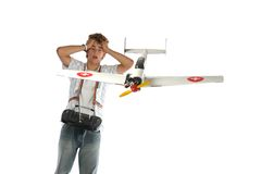 Boy with an airplane Stock Images
