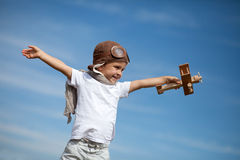 Boy with airplane on air fest Royalty Free Stock Photos