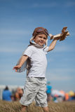 Boy with airplane on air fest Stock Photography