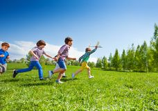 Boy with airplane and following him children run Stock Photos