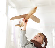 Boy with airplane in hand. Happy boy with airplane in hand Royalty Free Stock Image