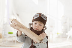 Boy with airplane in hand Royalty Free Stock Photos