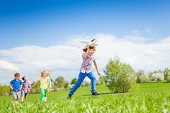Boy with airplane toy running fast and other kids Stock Photo