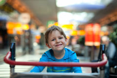 Boy at airport Royalty Free Stock Photo