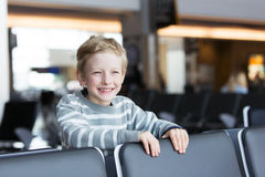 Boy at airport Royalty Free Stock Image