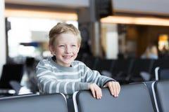 Boy at airport Royalty Free Stock Image