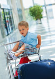 Boy in the airport. Little cute  baby boy in the airport Royalty Free Stock Photo