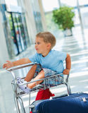 Boy in the airport. Little cute  baby boy in the airport Royalty Free Stock Images
