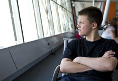 Boy in airport lounge Stock Images