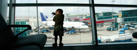 Boy on airport window background Royalty Free Stock Images