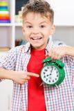 Boy with alarm clock Royalty Free Stock Image