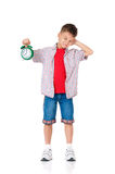 Boy with alarm clock Stock Photography